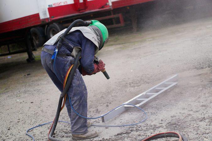 Mobile sandblasting services operator